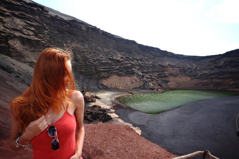Redhead woman on El Golfo on Lanzarote Island, Spain royalty free stock image