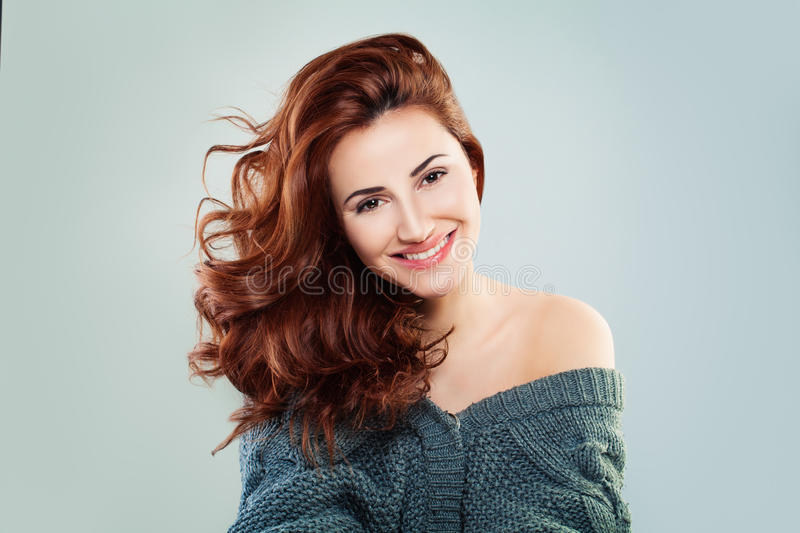 Redhead Woman Fashion Model Smiling. Pretty Girl on Grey Background stock images