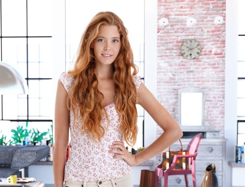 Redhead woman at home royalty free stock photo