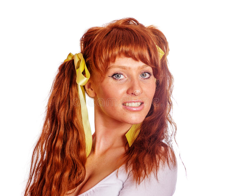 Redhead woman with ponytails. Redhead woman wearing ponytails isolated on white stock image