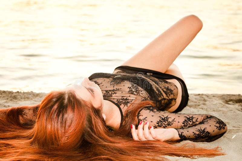 Download Redhead woman on sand stock image. Image of fashion, model - 25410329