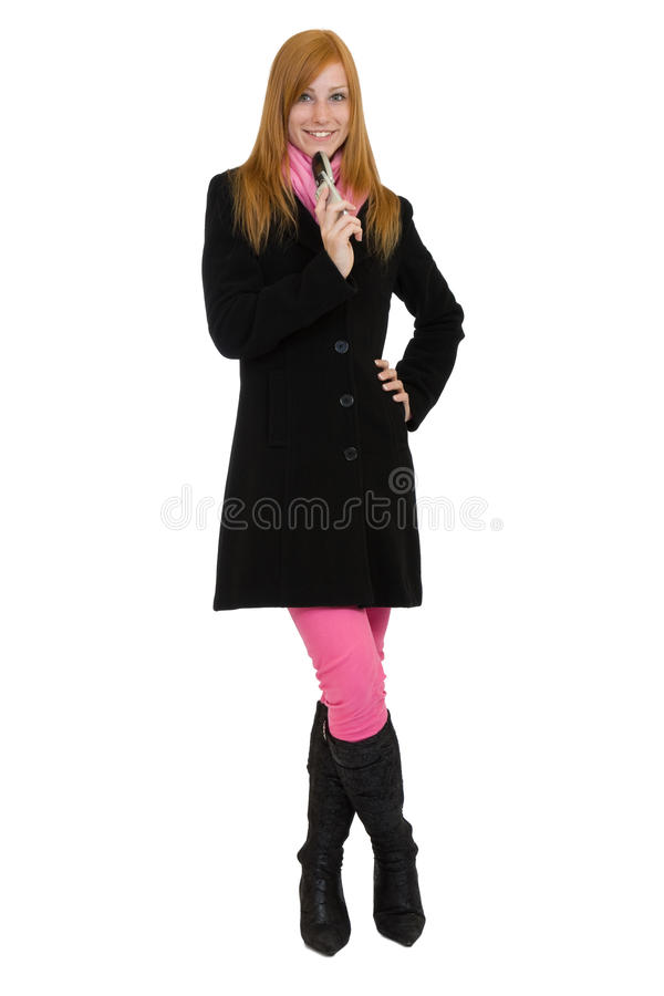 Redhead woman standing with cell phone royalty free stock images