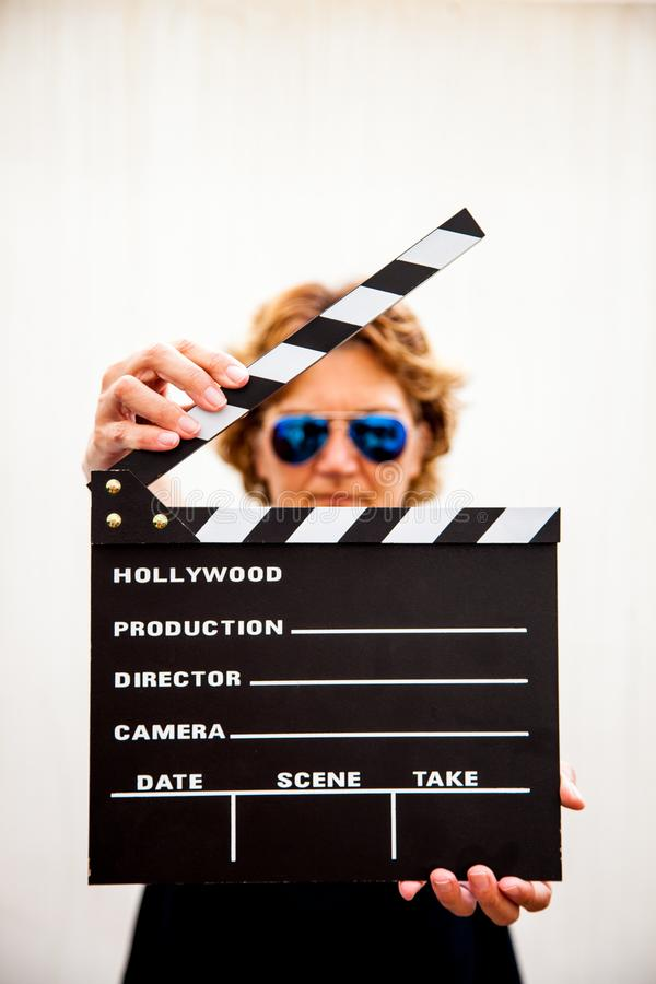 Woman holding a film slate stock photos