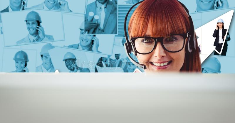Redhead woman using headset against portraits royalty free stock image