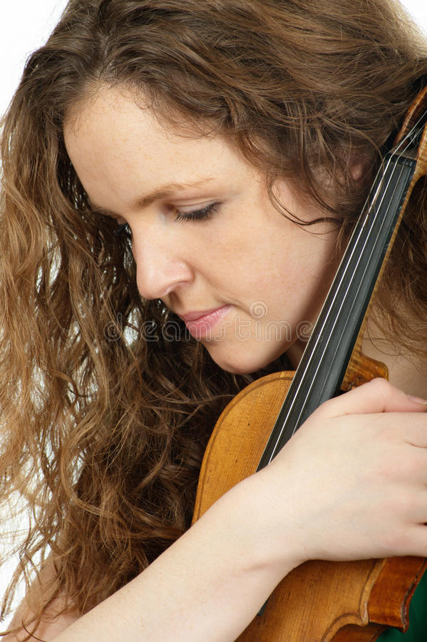 Redhead woman with violin royalty free stock image