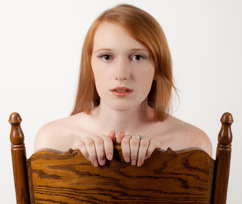Redhead and Wooden Chair
