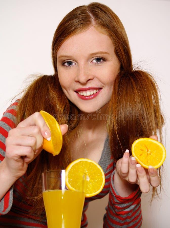 redheaded flickaorange arkivfoto