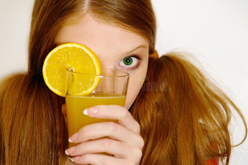 Download Redheaded  Girl With Orange Stock Image - Image: 10998463