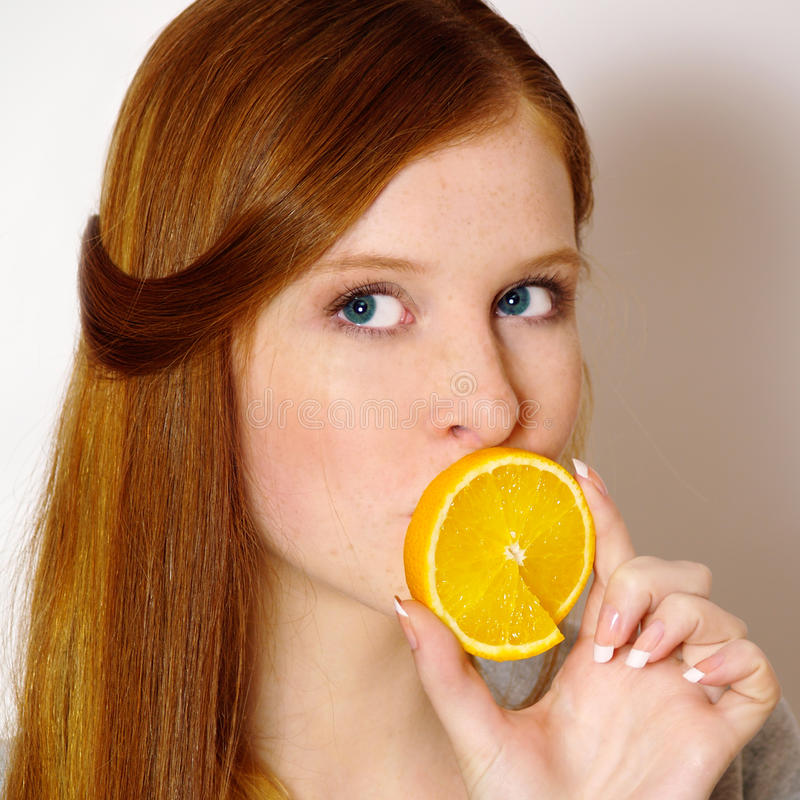 Download Redheaded  Girl With Orange Stock Image - Image: 10998499