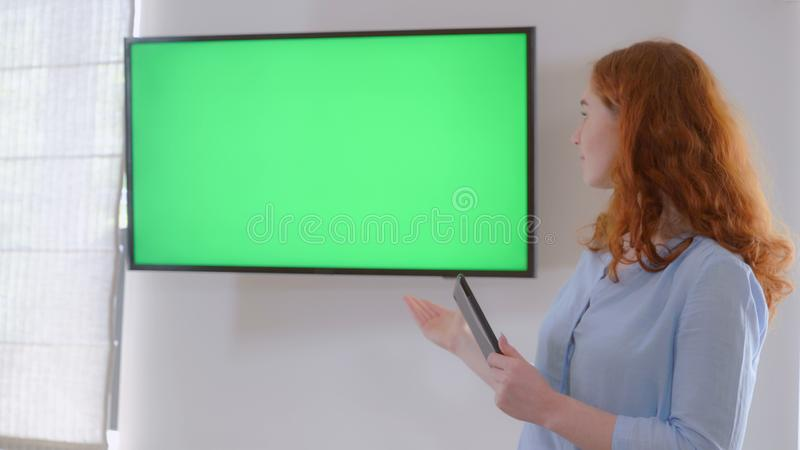 Female giving presentation. stock photography