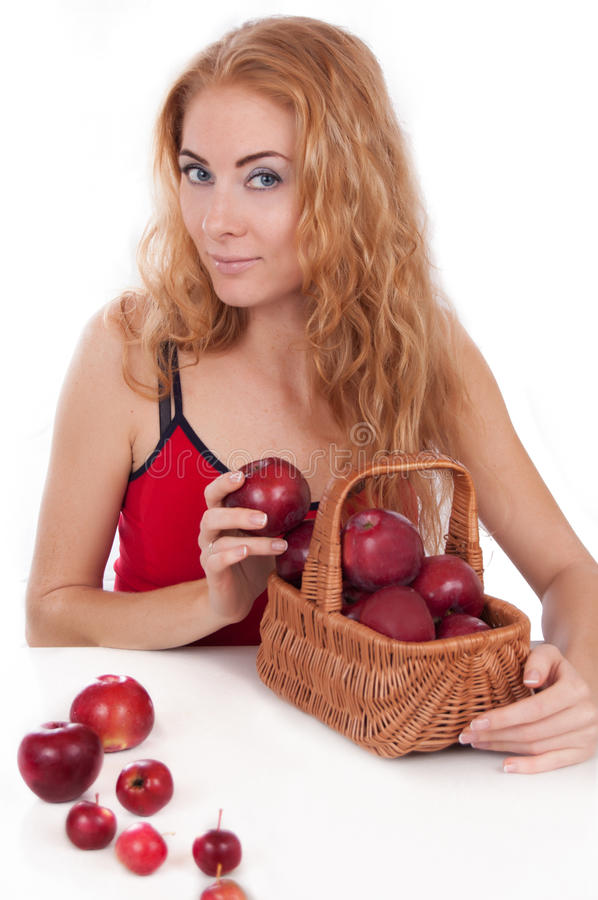 Redheaded Woman With Basket Of Apples Royalty Free Stock Photos