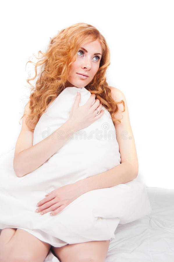 Redheaded Woman Holding Pillow Royalty Free Stock Photo