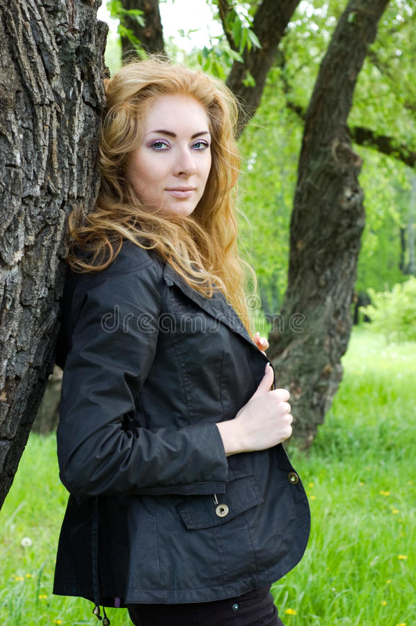 Download Redheaded Woman Near Tree Stock Image - Image: 19551491