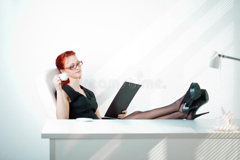 Download Redheaded Woman In The Workplace Stock Image - Image: 21874155