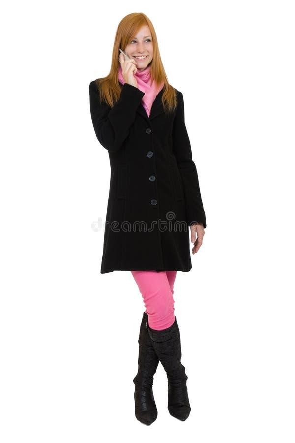 Redheadfrau, die einen Aufruf bildet lizenzfreie stockfotografie