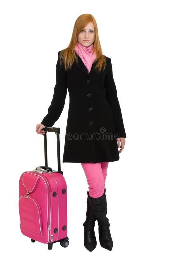 Redheadfrau, die geht zu reisen stockbild