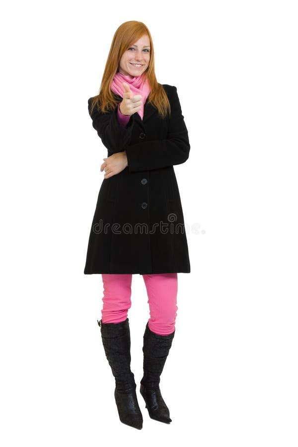 Redheadfrauenzeigen stockfotografie