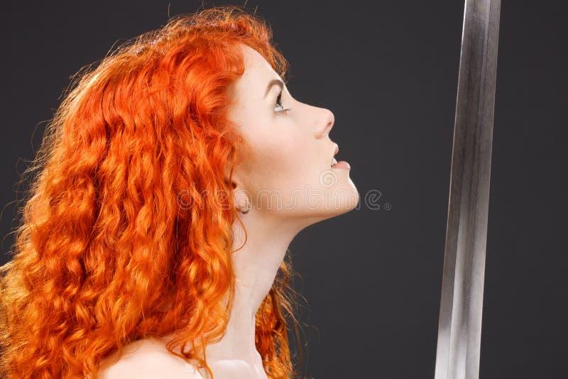 redheadkrigare arkivfoton