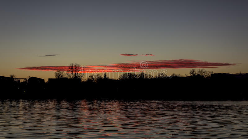 Redline Sunset. A red line on the sky at Titan Park, Bucharest stock photos