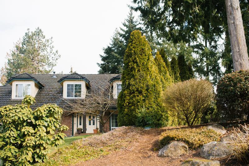 Redmond, United States. Private house surrounded by trees. Redmond, United States. April 2019. Private house surrounded by trees royalty free stock photo