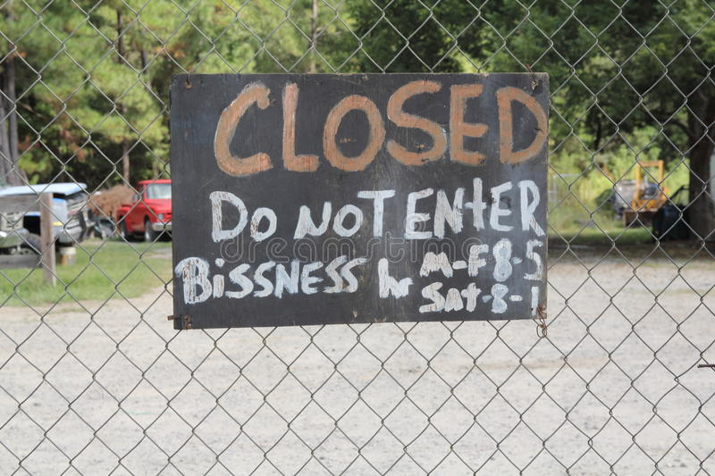 Redneck business closed. Misspelled redneck business sign closed stock photo