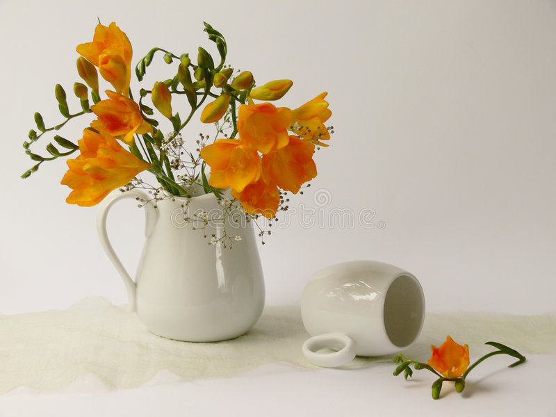Redolent. A cup yellow fragrances flowers in white jug royalty free stock photo