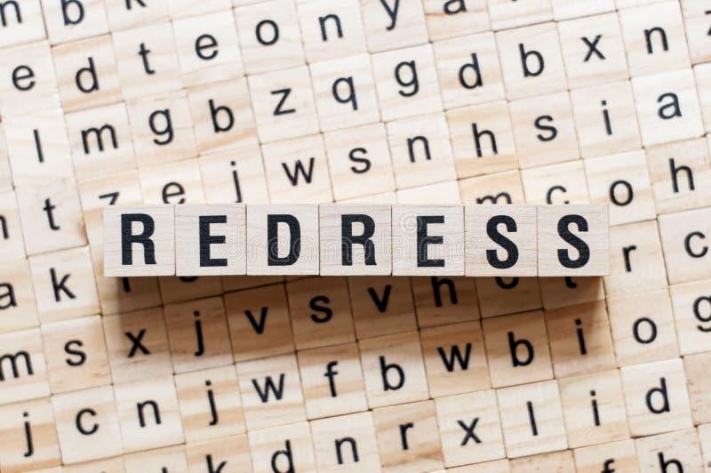 Redress word concept on cubes stock photos