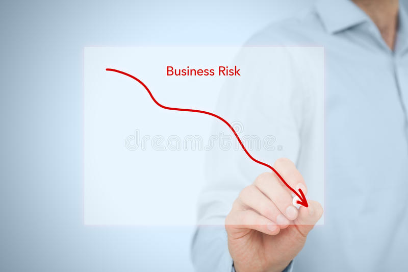 Reduce business risk. Concept. Business man draw simple graph with descending curve stock photo