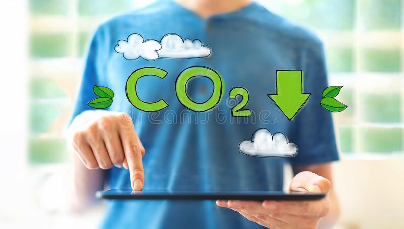 Reduce CO2 with man using a tablet royalty free stock photos