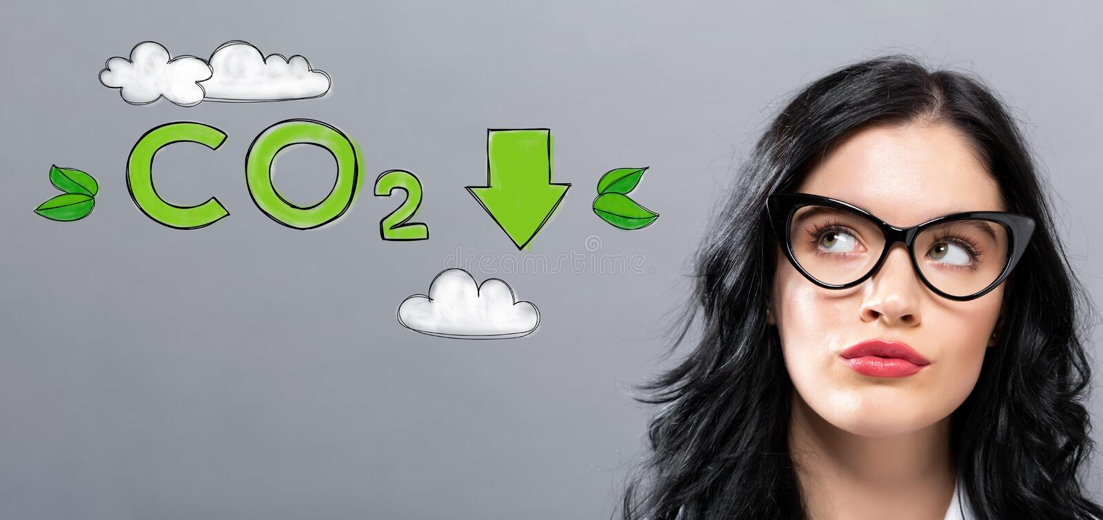 Reduce CO2 with young businesswoman stock image