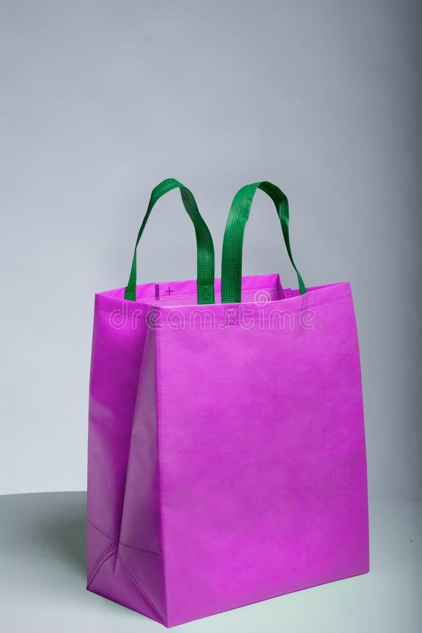 Free Reduce, Reuse, Recyclable Eco Friendly Non Woven Bag, Pink Color Bag And Green Handle Royalty Free Stock Image - 162739056