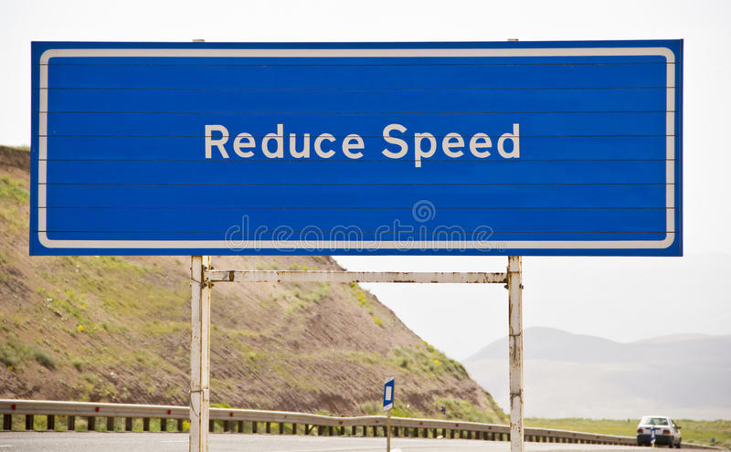 Reduce speed. Sign in road stock photography