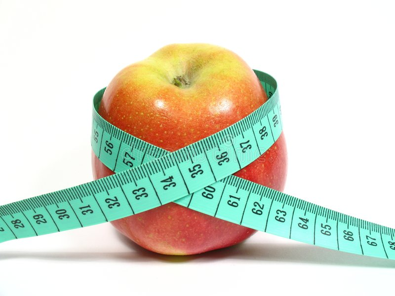 Reduced diet with apples. Red apple with centimeter with ideal measure stock images