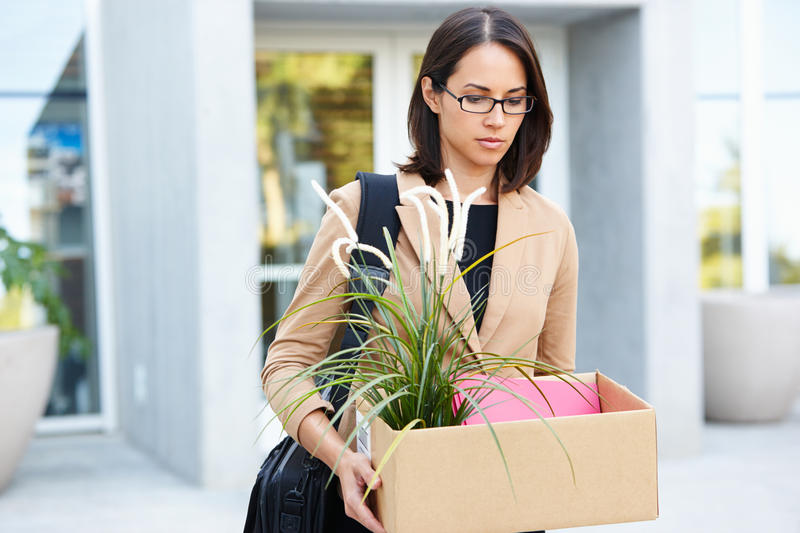 Redundant Businesswoman Leaving Office. With Box royalty free stock image