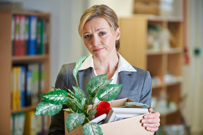 Redundant Businesswoman In Office. With Belongings royalty free stock photos