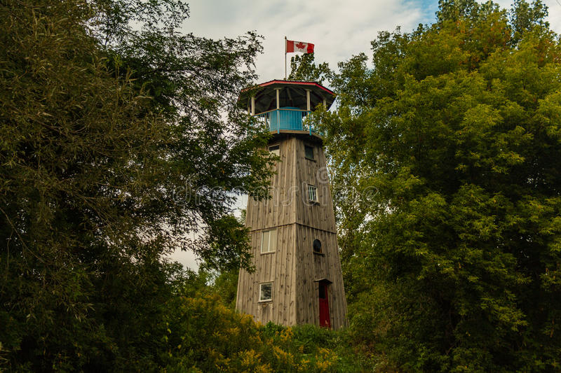 Redundant Lighthouse. This Lighthouse, once a form of warning to oncoming ships, is made redundant by the surrounding nature stock photos
