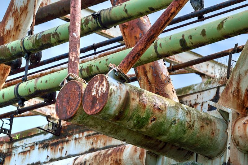Redundant Structure with Rusty Steelwork. Redundant disused steel structure in poor condition with much rust royalty free stock images