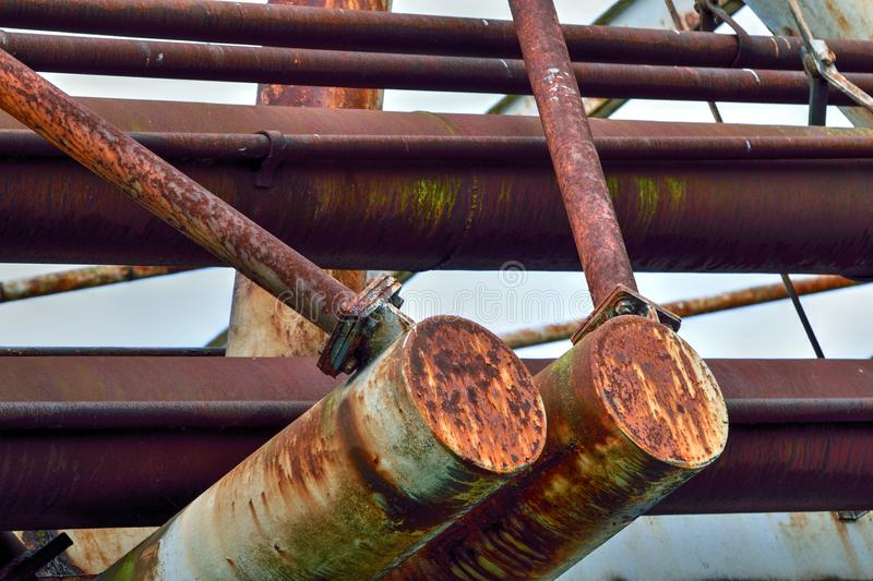 Redundant Structure with Rusty Steelwork. Redundant disused steel structure in poor condition with much rust royalty free stock photos
