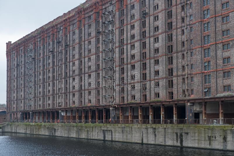 Redundant warehousing on the Mersey waterfront. A derelict Victorian warehouse at the disused Stanley Dock on the river Mersey waterfront, Liverpool stock photo