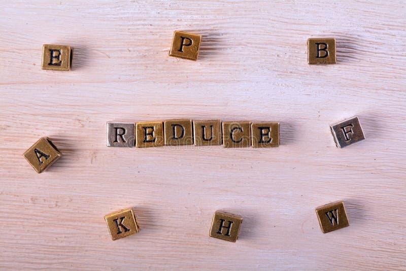 Reduzca el bloque del metal de la palabra imagen de archivo libre de regalías