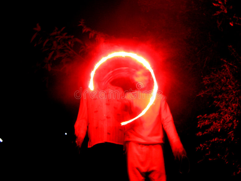 Redz Circlez. Children make a circle with a red sparkler in Diwali festival of India stock image