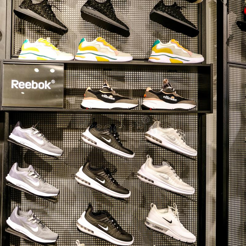 Reebok Trainers Display in a High Street Shop or Store. Reebok is and English Footwear and Clothing Business and a Subsidiary of the German Company Adidas royalty free stock photo