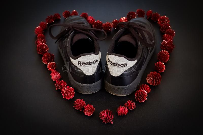 Reebok Shoes in red heart. Black Reebok Shoes in red heart of pineapples stock photos