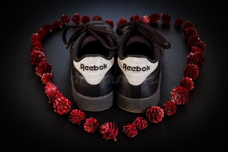 Reebok Shoes in red heart. Black Reebok Shoes in red heart of pineapples royalty free stock image