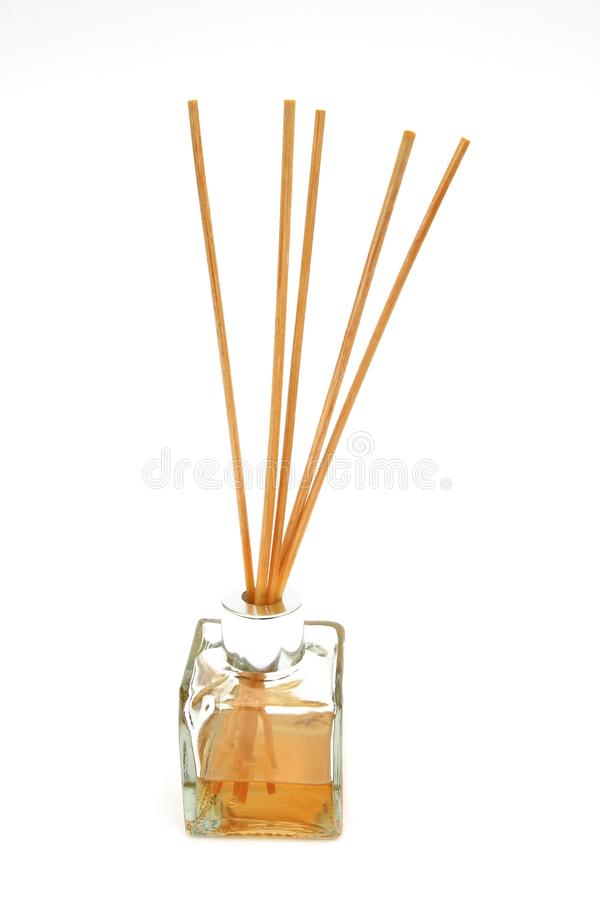 Reed diffuser, with reed sticks in a bottle of scented oil, on w royalty free stock photos