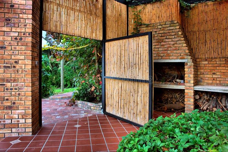 Reed door into garden stock image