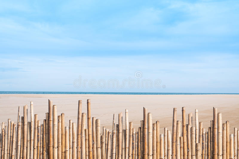 Reed fence bamboo on empty beautiful beach royalty free stock photos