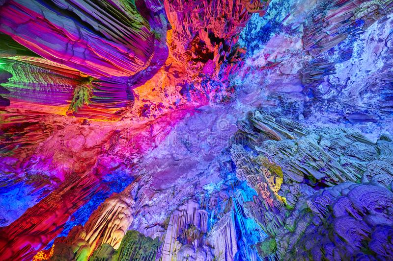 The Reed Flute Cave in Guilin, China. The Reed Flute Cave, natural limestone cave with multicolored lighting in Guilin, Guangxi, China royalty free stock photography