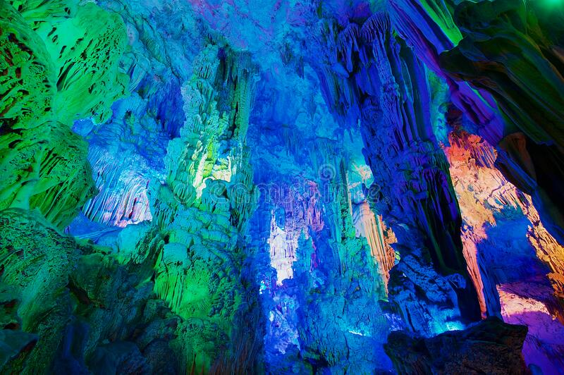 The Reed Flute Cave, natural limestone cave with multicoloured lighting is a landmark and tourist attraction in Guilin, China. royalty free stock photo