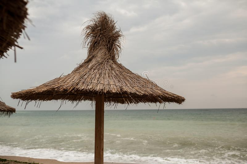 Reed roof on a beach at Black Sea royalty free stock images